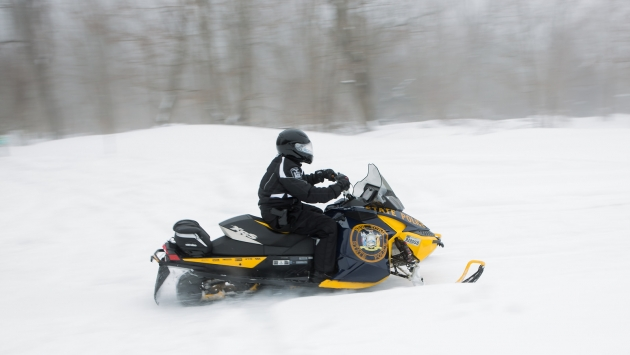 State Police member trains on a Division snowmobile.