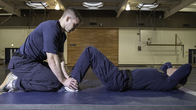 Example of proper form for sit up in down position.